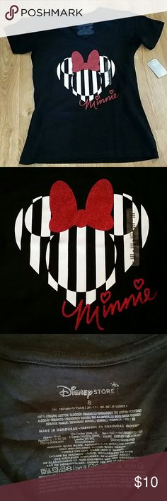 NWT Disney Black Shirt with Minnie Mouse Heart NWT Disney Black Shirt with Minnie Mouse Heart Black and White Stripes with Red Glitter Bow (Consider bundling to get more value out of the cost of Shipping and feel free to make offers on bundles) Thank you for visiting my closet!! SMOKE FREE CLEAN HOME Disney Tops Tees - Short Sleeve