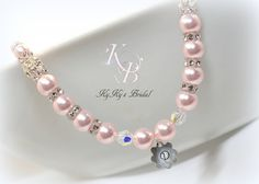 Choose from our large selection of beautiful Swarovski pearl colors for this precious personalized flower girl necklace.  The unique sterling silver flower charm is hand-stamped with her initial.