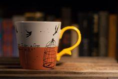 Charlotte Bronte I am no bird Jane Eyre literary quote mug - Medium large white, salmon, and yellow mug with birdcage and birds. $16.00, via Etsy.