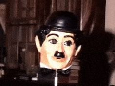 Watch this Charlie Chaplin's mask turn inside out.
