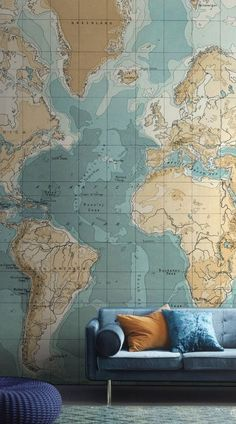 Create the ultimate feature wall in your home with this beautiful map wallpaper mural. The muted shades of blue and brown give this living room a vintage luxe feel.