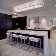 Amazing kitchen. Clean, crisp white with dark cabinets