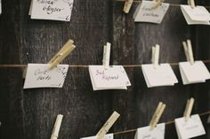 Vintage inspired escort card display at barn reception. Photos by Sonoma wedding photographer, Tinywater Photography, http://tinywater.com.
