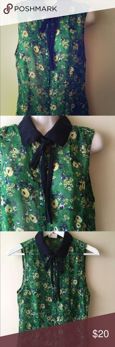 Tommy girls bow tie blouse Tommy girl bow tie floral blouse. Sleeveless in green and navy. Navy blue collar accents sheer floral print. Close jrs but fits like a s/m Tommy Hilfiger Tops Blouses