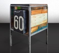 Kicthencabinet made from scrapwood and an old industrial bin