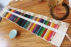If you love to color, you've probably accumulated a lot of coloring supplies. Bring order to the chaos with these organization tricks for colored pencils. Roll Up Pencil Case, Diy Pencil Case, Pencil Boxes, Pencil Pouch, Colored Pencil Holder, Coloured Pencils, Colored Pencil Storage, Pencil Case Pattern, Sewing Crafts