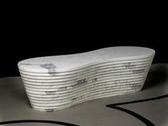 Paolo Ulian and Moreno Ratti have designed a bench made from Carrara marble that was cut by water jet.