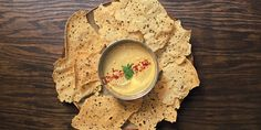 Chips and dip: classic, and every culture has its take. There's hummus and pita, tortilla chips and guac, British chips and tartar sauce... From time to time, we'll run an Indian take on chips and dip using crunchy papadums (thin and crispy lentil crackers) with a cold, creamy version of dal (stewed beans and lentils). The trick is to keep the dal super light so it doesn't snap the papadums.