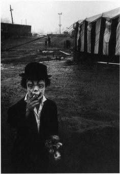 "I have a postcard of this image that reads: ""Jimmy Armstrong The Clown, Clyde Beatty Circus, 1958."" This photograph is by Bruce Davidson.  However, on the Metropolitan Museum of Art website Davidson's photograph is labeled, ""Clown and Circus Tent.""  More info here: http://www.metmuseum.org/Collections/search-the-collections/190021926"