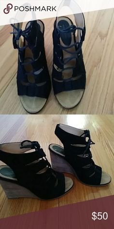 Black and tan wedge sandal Black and tan wedge sandal. Only worn three times. Great condition from Nordstrom Melrose and market Shoes Platforms
