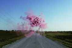 """Texas-based artist Irby Pace's works can be described as haunting and ethereal. In his series """"Idle Voids,"""" Pace uses various outdoor spaces and adds his own """"pop"""" of color to each environment in the form of cloud-like explosions."""