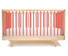 This sweet modern crib comes in a variety of colors and converts to a toddler bed. :) $695