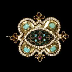 Brooch Part of a Parure (see below) A.W.N. Pugin Gold, Enamel, Garnet, Rubies, Turquoise, Pearls This, and all related images: The Victoria & Albert Museum