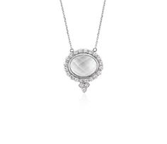This pendant is highlighted by white topaz and white sapphire gemstones framed in 18k white gold with a matching cable chain necklace.