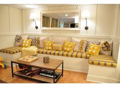 Great basement remodel, love this banquet seating with storage.