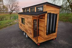 This is the Escapade Tiny House on Wheels. It's built by Baluchon in France. Please enjoy, learn more, and re-share below. Thank you! Escapade Tiny House Modern Tiny House, Tiny House Living, Tiny House Plans, Tiny House On Wheels, Tiny House Design, Living Room, Tiny House France, Houses In France, Tiny House Movement
