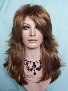Beautiful, layered Strawberry Blonde wig with long bangs  http://www.newattitudewigs.com/NirvanaTarah27.html