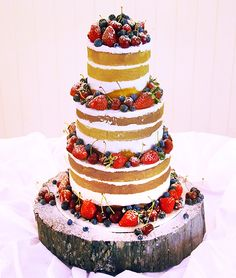 Summer Wedding cake naked with fresh berries and cream