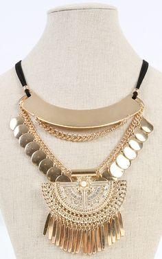 Stay free spirited with this bold statement tribal charm necklace. I MakeMeChic.com