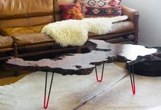 DIY NEON TABLE    I want to do this!! You can find burl or wood slabs online, order the hairpin legs online too. I love the sheepskin, the hide rug, the spanish or geometric tables, the contrast of textures. This is a very modern, but mid-century inspired and masculine room.