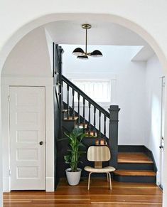 It may be small and narrow, but that doesn't mean your stairway can't get the same decorating treatment as the rest of your house. These staircase decorating ideas will give your entryway a step up. Find and save ideas about Painted stairs. Black Stairs, Black Banister, Black Painted Stairs, Painted Staircases, Painted Stair Risers, Bannister Ideas Painted, Staircase Painting, Entryway Stairs, Entryway Paint
