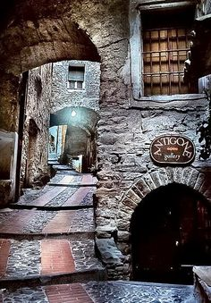Medieval Village of Dolceacqua, Italy----- did anyone else immediately think of Knockturn Alley from Harry Potter?