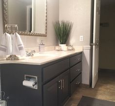 Bathroom Remodel - Coastal Style with Dark Gray Vanity Cabinets  Behr paint, coastal remodel, white and grays. wainscoating, DIY, Bathroom flip, Homegoods