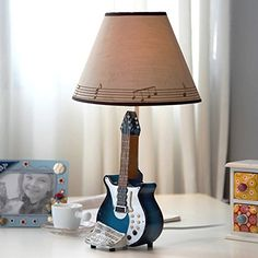 CENG Guitar music bell creative lamp / bedroom bedside lamp / table lamp dimmable Decoration CENG Table Lamp http://www.amazon.com/dp/B011LO6ML4/ref=cm_sw_r_pi_dp_xTPTvb0FCBMJT