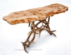 """This beautiful antler sofa table starts with """"real"""" naturally shed elk antlers. Each antler sofa table is handcrafted by a Woodland Creek artisan with fifteen years experience building antler furniture. The top show is a gorgeous live edge burl wood slab. The natural edge slab is shown in its natural color. It also looks great"""