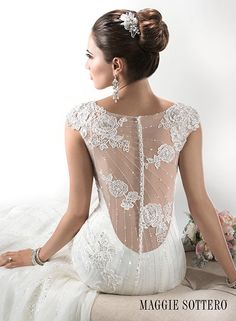 We're absolutely smitten over the dramatic back of this wedding dress by Maggie Sottero, Savannah Marie. Complete with cap-sleeves.
