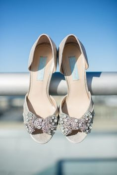 Silver Betsey Johnson peep-toe peeps with sparkly bows