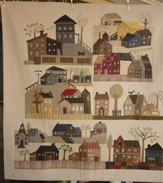 I finished   machine quilting my wallhanging with the houses. I try and do the smaller quilts I make and leave my large quilts to the p...