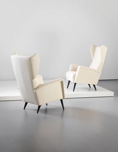 PHILLIPS : NY050213, GIO PONTI, Pair of wingback armchairs, designed for the Hotel Royal, Naples