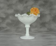 Crimped Round Milk Glass Compote in the English Hobnail pattern signed by Westmoreland by TreasuryShop on Etsy https://www.etsy.com/listing/191449181/crimped-round-milk-glass-compote-in-the
