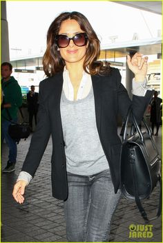 Salma, why do insist of dressing like a DC? These Jackie O glasses and collared-shirt+sweater combo make her majestic features look unnaturally angular, and that blazer is too long for her. The jeans, however, are on point for a TR - they show the delicate curvy lines of her legs very well.