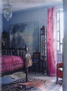 This epitomizes bohemian to me. Saturated yet faded colors, worn fabrics, old furniture, all put together as if they were drug out of the attic and arranged by someone with more taste than money.
