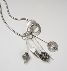 """Sterling Charm Necklace with Baubles""  Silver Necklace  by Caroline Viene  $1,200"