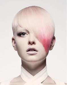A short blonde straight coloured white long fringe hairstyle by Mieka Hairdressing