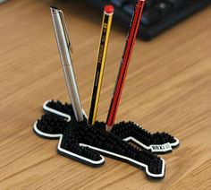 Brighten up your day & general desk area, with this cheeky pen/pencil holder. Pens and pencils stand up right in silicone prongs. If your desk looks like a Office Desk Organization, Cool Office Desk, Desk Tidy, Office Storage, Work Desk, Office Table, Gadgets And Gizmos, Cool Gadgets, Cool Office Gadgets