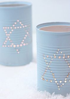 Punch holes in empty tin cans for easy DIY candle holders.
