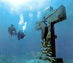 """""""Cross of the Bay"""" - island of Isla, Mujeres, Mexico A bronze cross weighing a ton, 30 feet high and 9-3/4 wide. Is a tribute to all the men and women who died at sea."""