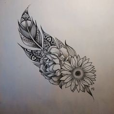 Mandala styled feather with flower drawing in pen