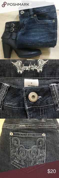 """NWOT- Freestyle cropped semi-distressed denim 7 NWOT- Freestyle 5pocket, cropped, semi-distressed dark denim with white contrast stitching and raised scroll design on back pockets. Size7. Waist 15.5"""" (unstretched- easily stretches to 17""""), Rise 7.5"""", Inseam 23"""".  Perfect length to showcase cute bootie or statement heel on date night. Last 2 photos are best color representation. Excellent unused condition. Smoke Free Home  Freestyle Jeans Ankle & Cropped"""