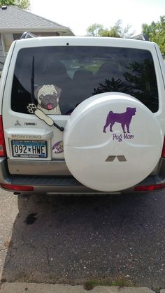 Waving Pugly #pug WiperWags attach to rear vehicle windows and wipers. This Pug Mom is sporting on her Montero SUV.