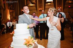 This bride was not so nice to her groom when it came time to cut the cake!  Photo Credit: Jennifer Childress   www.Hoteldupont.com/weddings