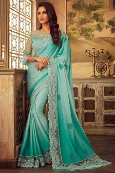 Sea green Silk Saree with Light sea green Silk blouse, embellished with dori work, resham work and stone work. Saree with Round Neck, Half sleeve. It comes with unstitch blouse, it can be stitched 32 to 58 sizes.