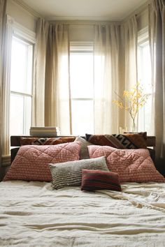 looks inviting #bed #organic #textures #layers #patterns #red #home #interior #decor #south_american #wood #white #brown
