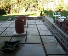 excellent idea for expanding the patio area... pavers evenly spaced. crushed stone and sand underneath. gravel on top, for spaces between. Stone seat wall perimeter.