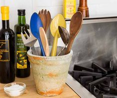 A weathered, heat-resistant terra-cotta pot by the stove can stylishly store the few cooking utensils you use every day.