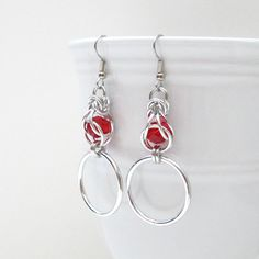 Chainmaille earrings, captive red crystals by TattooedAndChained